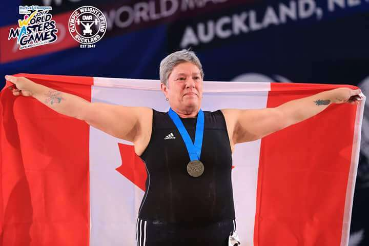 this is a photo of sue spencer winning a gold medal at the world masters games in auckland
